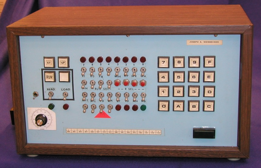 System 00 front panel, with a hex keypad and rows of toggle switches, buttons, and lights.